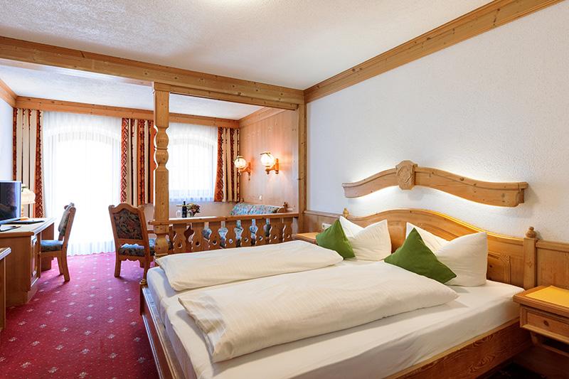 Komfortzimmer mit Wohnteil und Balkon