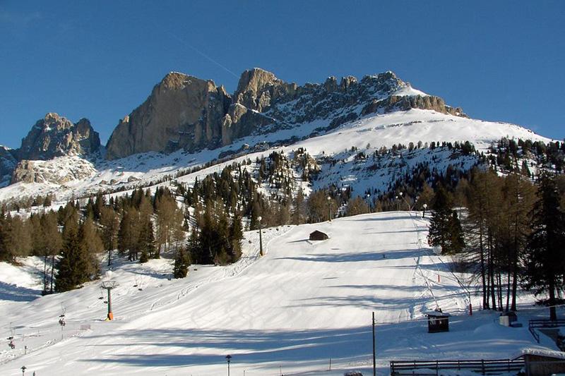 Winterurlaub in den Dolomiten zwischen Skigebiet und Schneeidyll