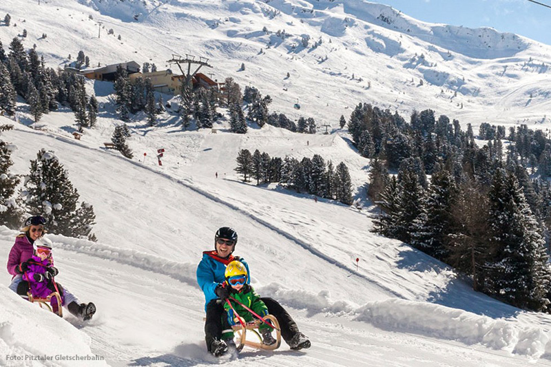 Winterzauber in Tirol: Rodeln, Schlittenfahren, beleuchtete Rodelbahnen