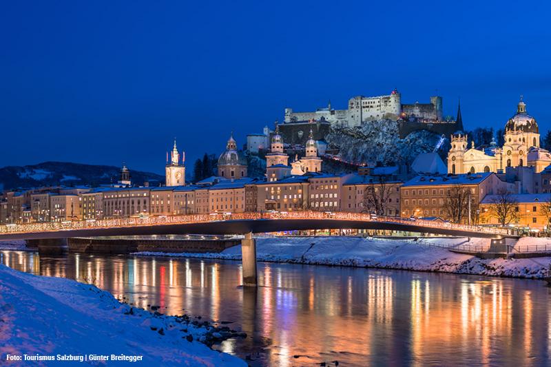 Winterurlaub in Salzburg im Hintergrund sieht man das Wahrzeichen der Mozartstadt: die Festung Hohensalzburg